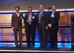 Pandell President & CEO, Greg Chudiak (second from left), accepted the award Tuesday evening