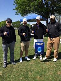 A group of golfers taking a shot with Pandell
