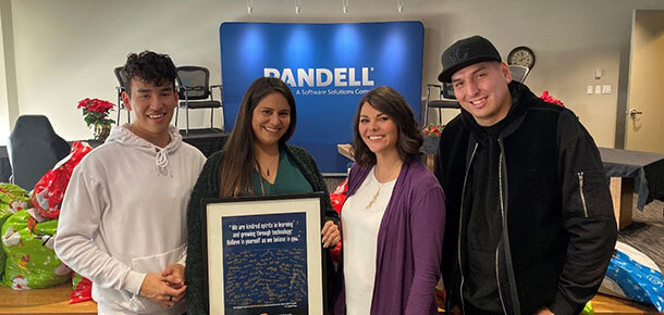 USAY charity members pose for a picture inside the Pandell office